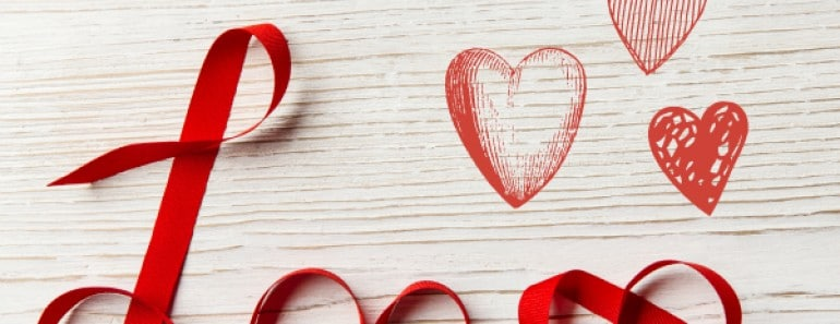 Love Ribbon Word Twisted over White Wooden Background. Valentine Day Concept.