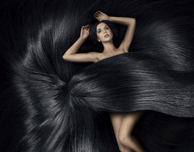 Beautiful woman lying on the hair and cover her body