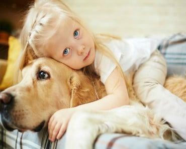 Cute child lying on fluffy pet