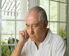 close up of elderly man ost in thought