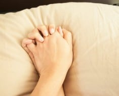 Making love in bed focus on hands