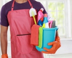 Portrait of hand with cleaning equipment ready to clean house